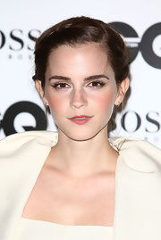 Emma Watson pulled her hair back in a braided updo for the GQ Men of the Year Awards.