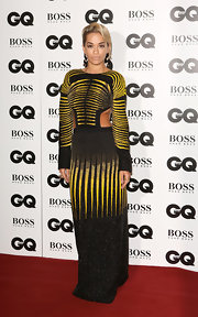 Rita Ora looked modern and sexy in a black and yellow evening dress with side cutouts at the GQ Men of the Year Awards.