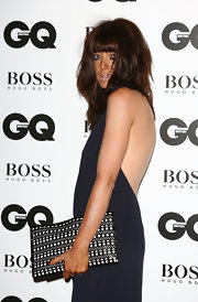 Claudia Winkleman attended the GQ Men of the Year Awards carrying a stylish black-and-white printed clutch.