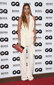 Amber Le Bon styled her outfit with a two-tone croc-embossed clutch.