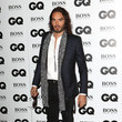 Russell Brand in Futuristic Boots and a Midnight Blue Blazer