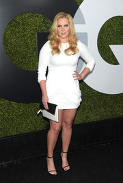Amy Schumer went for a leggy look in a white mini dress with drapey accents on the skirt during the GQ Men of the Year party.