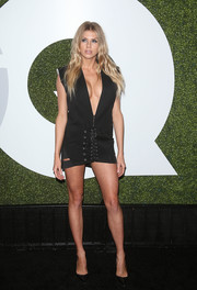 Charlotte McKinney bared her cleavage and legs in a plunging lace-up LBD by Anthony Vaccarello at the GQ Men of the Year party.