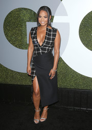 Christina Milian styled her sexy frock with silver evening sandals.