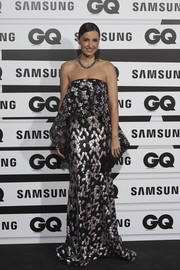 Monica de Tomas looked ultra glam in a strapless, sequined gown with a foldover bodice at the GQ Men of the Year Awards.