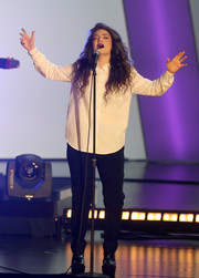 Lorde teamed her shirt with tapered black trousers.