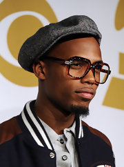 B.O.B donned a classic newsboy cap while attending the Grammy nominations concert.