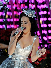 Katy Perry topped off her sparkling cocktail dress with an arm full of matching bangle bracelets.