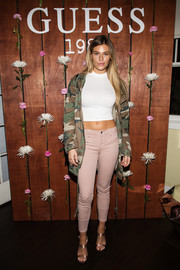 Samantha Hoopes showed off her curves in a skintight white crop-top at the Guess 1981 fragrance launch.