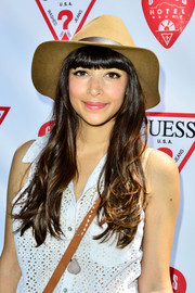 Hannah Simone looked cool wearing this brown walker hat at the Guess Hotel party.