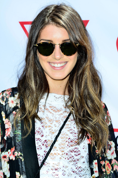 Shenae Grimes attended the Guess Hotel party wearing her hair in subtle waves.