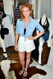 Brittany Snow completed her cool ensemble with flat blue T-strap sandals.