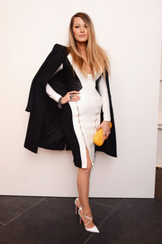Blake Lively showed off her post-baby figure in a body hugging black and white dress.