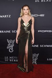 Rachel Hilbert gleamed in a high-slit gold wrap gown at the Angel Ball 2016.