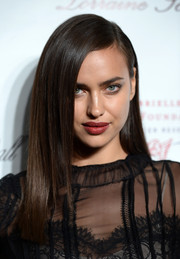 Irina Shayk styled her hair in a sleek straight side-parted 'do for the Angel Ball.