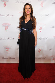 Brooke Milstein attended the Angel Ball wearing a black Grecian gown with an embellished waist.