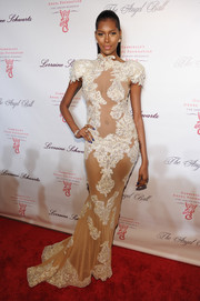 Jessica White sent pulses racing at the Angel Ball in a sheer nude Michael Costello gown featuring white lace appliques.