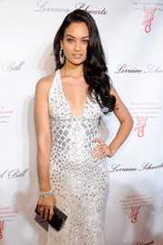 Shanina Shaik completed her sophisticated look with a black hard-case clutch when she attended the Angel Ball.