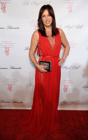 Ingrid Vandebosch looked divine at the Angel Ball in a red Grecian gown with a revealing neckline.