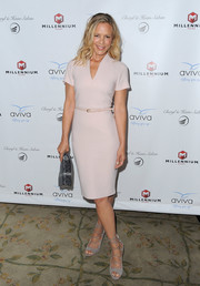 Maria Bello styled her dress with gray suede lace-up heels.