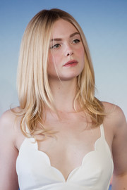 Elle Fanning looked sweet with her bouncy layered cut at the Deauville American Film Festival photocall for 'Galveston.'