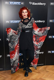 Natalia Tena sported unique number with this black, red, and gray frock with floor-length angel wing-style sleeves.