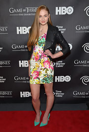 Sophie Turner mixed florals and leather when she paired this classic leather jacket with a feminine, floral frock.