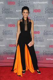 Nathalie Emmanuel stole the limelight at the 'Game of Thrones' season 4 premiere in a dramatic black Georges Chakra Couture jumpsuit featuring a spiked yoke, sultry sheer panels, and a train with marigold lining.
