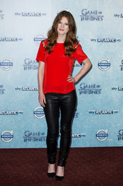 Rose Leslie went for an edgy finish, teaming her blouse with a pair of black leather pants.