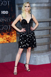 Sophie Turner teamed her dress with strappy black sandals, also by Louis Vuitton.