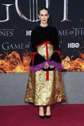 Sarah Paulson looked opulent in a Gucci dress with a black velvet bodice, a gold skirt, red bow detail, and purple cuffs at the 'Game of Thrones' season 8 premiere.