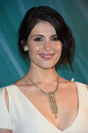Gemma Arterton complemented her low-cut dress with a luxurious diamond chandelier necklace.
