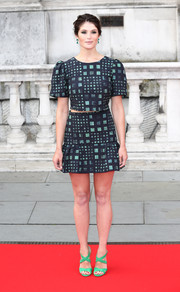 Gemma Arterton added an extra pop of green with a pair of Jimmy Choo crisscross-strap sandals.