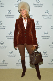 Sonja Morgan sported an equestrian-inspired outfit, consisting of a brown velvet blazer and a pair of skinny pants, during Mercedes-Benz Fashion Week.