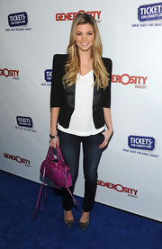 Amber wears a strong-shouldered blazer with satin lapels for the Night of Generosity Benefit.