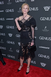 Nicole Kidman flashed plenty of skin in this asymmetrical lace-panel LBD during the New York premiere of 'Genius.'