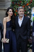 Amal Clooney paired a leopard-print clutch with a navy one-shoulder jumpsuit for the People's Postcode Lottery Charity Gala.