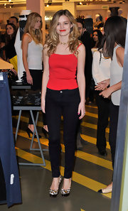Georgia wears a basic red tank with her black jeans for the Hudson photocall in London.