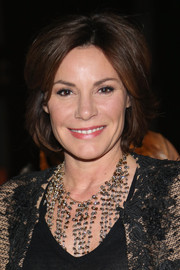 LuAnn de Lesseps attended the Georgine Fall 2015 show wearing her hair in a center-parted bob.