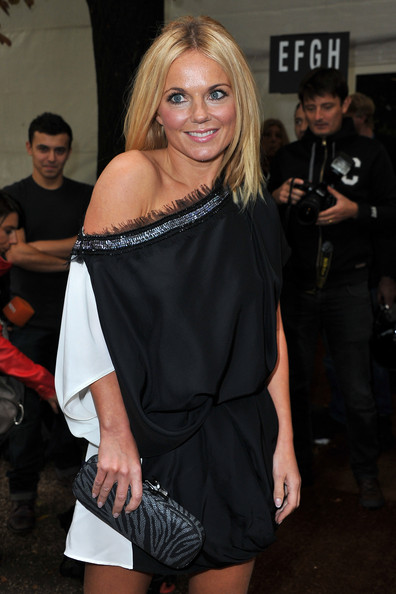 Geri Halliwell Hard Case Clutch [shoulder,clothing,joint,fashion,dress,blond,leg,little black dress,human body,thigh,geri halliwell,front row,paris,france,viktor rolf,espace ephemere tuileries,paris fashion week,show,viktor rolf ready to wear spring]