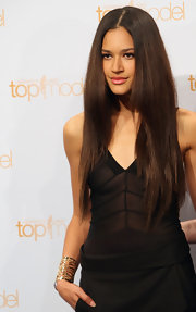 Lovelyn Enebechi glammed up her look with a fab gold meshwork bracelet at the photocall for 'Germany's Next Top Model.'