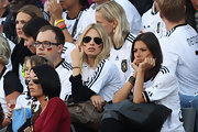 Sarah Brandner watched a football match looking cool in her aviators.