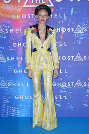 Adwoa Aboah got majorly retro in a yellow bell-bottom pantsuit by Gucci for the Paris premiere of 'Ghost in the Shell.'
