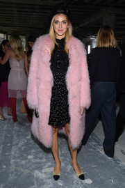 Chiara Ferragni made a glam arrival at the Giambattista Valli fashion show in a pink fur coat.