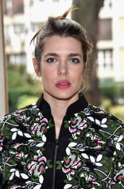 Charlotte Casiraghi brightened up her pretty face with a swipe of pink lipstick.