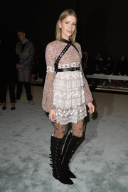 Elena Perminova injected an extra dose of edge with a pair of multi-buckled knee-high boots.