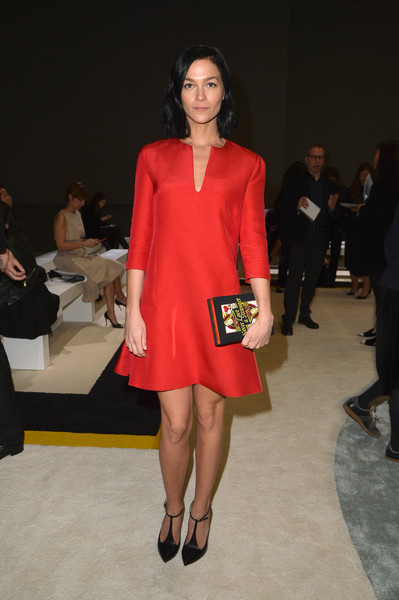Leigh Lezark accessorized with a book clutch for a fun finish to her look.