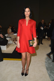 Leigh Lezark kept it classy in a red cocktail dress during the Giambattista Valli fashion show.