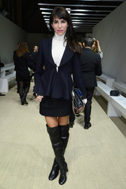 Caroline Sieber teamed her stylish jacket with a simple black mini and a white turtleneck.