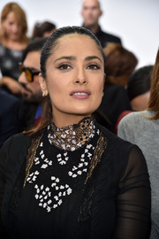 Salma Hayek styled her hair into a tight ponytail for the Giambattista Valli fashion show.